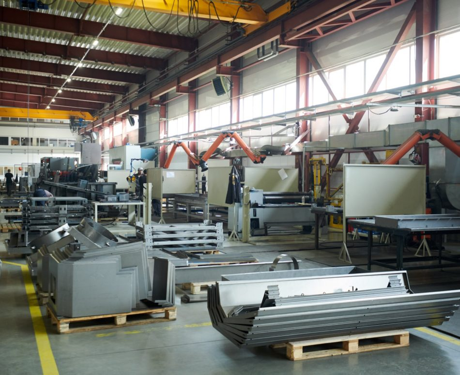 Wide angle background shot of empty factory workshop with machines ready for assembling, copy space